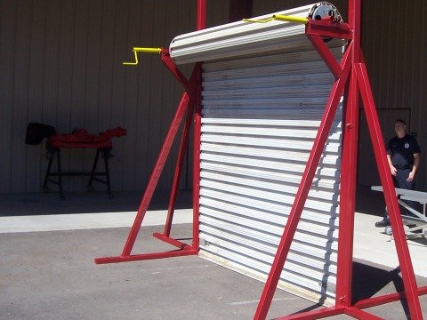 ... door secure it and go! The prop can be broken down into 4 pieces for storage or transport and can be fixed to the ground by spikes when necessary. & Roll-Up Door Prop | VentEnterSearch.com